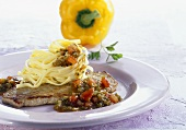 Veal escalope with pepper sauce and pasta