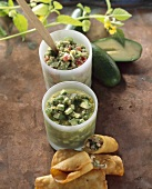 Taquitos with avocado dip and tomatillo dip