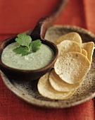 Herb and chili chutney with poppadom