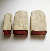 Three pieces of dry-cured beef (Bündnerfleisch)