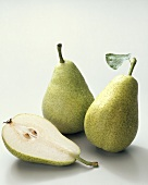 Pears (Pyrus communis), variety 'Dr. Guyot', whole and halved