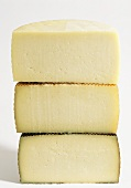 Manchego, cut in half, at three stages of maturity