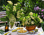 Elderflower fritters and elderflowers in vases