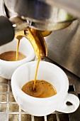 Espresso running into two espresso cups
