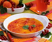 Cold peach and redcurrant soup