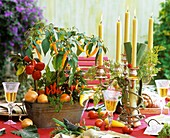 Table decoration with candles and vegetables
