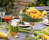 Nachos in a glass bowl with corn decoration