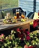 Iced tea and flower wreath on a wooden table