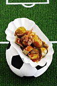 Half-time snack - curry sausage on a football