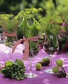 Table decorated with dill, vine leaves and chestnuts