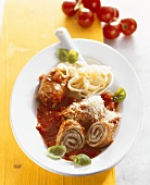 Roulades in spicy tomato sauce with ribbon pasta