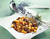 Autumnal lamb ragout with swedes and lavender flowers