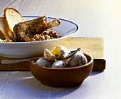 Braised lamb shanks with lentils, white bread, potatoes