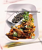 Duck with vegetables cooked in the wok (Asia)