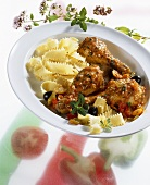 Chicken thighs in vegetable sauce with ribbon pasta
