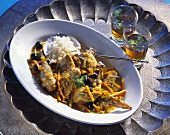Guinea-fowl with pumpkin and olives (Tunisian dish)