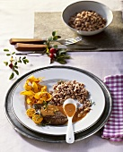 Venison steaks with rose hip sauce and chestnut spaetzle