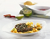 Grilled ostrich steak with mango and coconut sauce