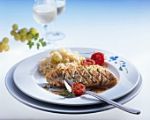 Zander fillet with sauerkraut, grapes and cherry tomatoes