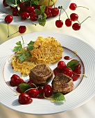 Venison medallions with cherry sauce and potato rosti