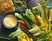 Raw vegetable salad with two dips