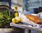 Still life with fresh salmon, lemon, greens and olive oil