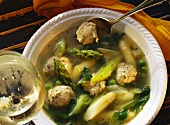 Asparagus soup with meat dumplings