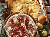 Pear tart with sour cream topping and redcurrant tart