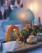 Shrimps in potato case, goose liver balls, salmon tartare