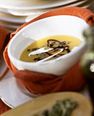 Pumpkin soup with pumpkin seeds, pumpkin seed oil & cream