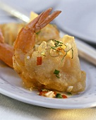 Scampi in rice paper with small pieces of vegetable