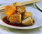 Baked tofu cubes with sesame seeds & carrot butterfly