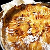 Peach tart with icing sugar