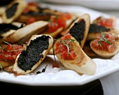 Crostini alla crema di olive e bruschette (Toasted bread snacks)