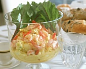 Egg salad with pineapple & shrimps, a few baguettes nearby
