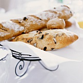 Olive breads and rolls on wire basket with napkin
