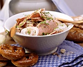 Bavarian sausage salad with onion rings & chives