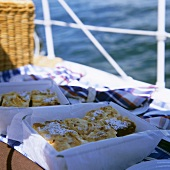 Quark apricot slices in picnic containers on boat