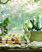 Buffet with champagne, bottles, drinks & various snacks