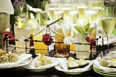 Buffet with champagne, drinks & various snacks (close-up)