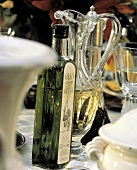 A Bottle and Glass Pitcher of Extra Virgin Olive Oil