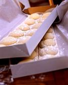 Home-made ravioli in cardboard boxes