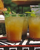 Mexican drinks with orange juice and ice cubes