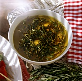 Olive oil and herb marinade with rosemary, thyme and oregano