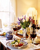 Elegant Table Setting with Hors d'Oeuvres and Red Wine
