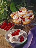 Profiteroles with mascarpone cream and raspberries