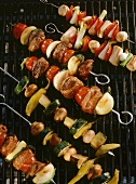 Grilled kebabs with vegetables, lamb & sausages
