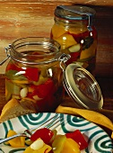 Sweet and sour hot peppers in jars