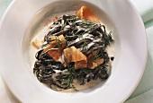 Black tagliatelle with smoked salmon & ill in cream sauce