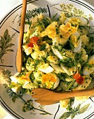 Potato salad with herbs, hard-boiled eggs & flowers